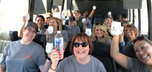 Tour attendees raise their drinks
