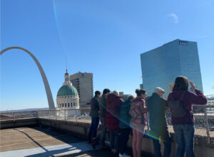 Tour looking at view of St. Louis
